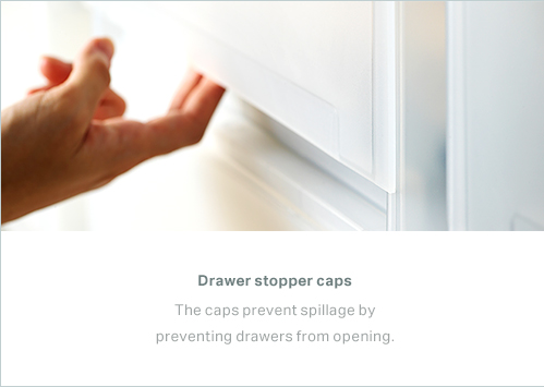 Drawer stopper caps - The caps prevent spillage by preventing drawers from opening.